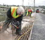 ICS 680GC Concrete Chainsaw Plunge Cutting on the Tacoma Narrows Bridge in Washington State.
